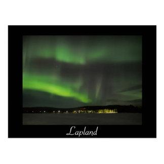 Aurora borealis in the sky black text postcard