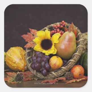Autumn cornucopia with grapes, pear and gourds square sticker