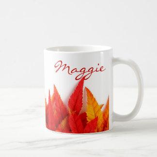 Autumn, fall leaves. orange, red, yellow, bright. coffee mug