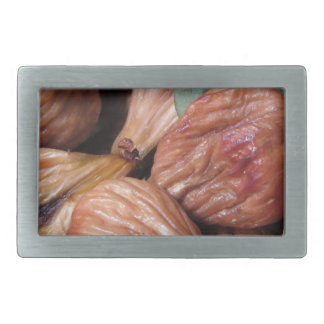 Autumn fruits . Closeup of dried figs with leaves Belt Buckle