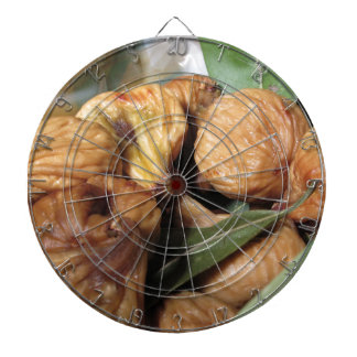 Autumn fruits . Closeup of dried figs with leaves Dartboard