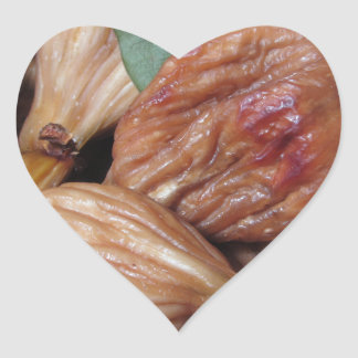 Autumn fruits . Closeup of dried figs with leaves Heart Sticker