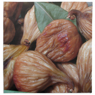 Autumn fruits . Closeup of dried figs with leaves Napkin