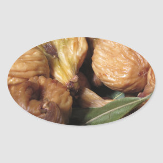 Autumn fruits . Closeup of dried figs with leaves Oval Sticker