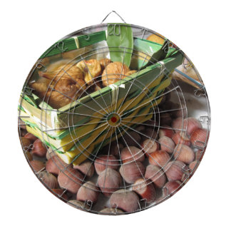 Autumn fruits with hazelnuts and dried figs dartboard