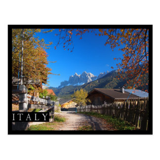Autumn in a village in the Dolomites in Italy Postcard