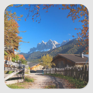 Autumn in a village in the Dolomites in Italy Square Sticker