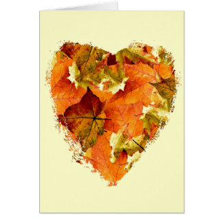 Autumn leaves in a heart shape, blank card