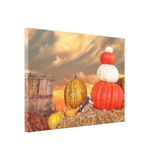 autumn pumpkins on hay baleswith sunset sky canvas print