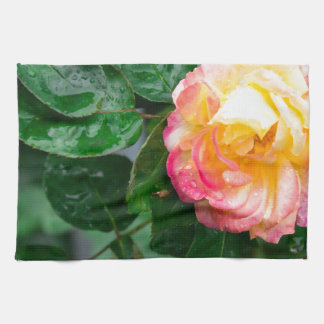Autumn withered rose with raindrops tea towel