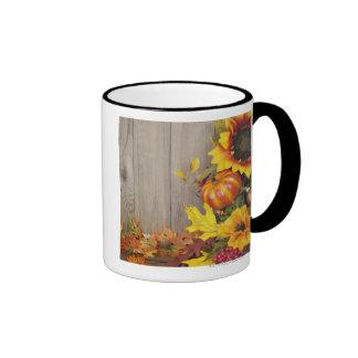 Autumn wreath and leaves on wood background mug
