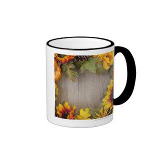 Autumn wreath on wood background coffee mugs