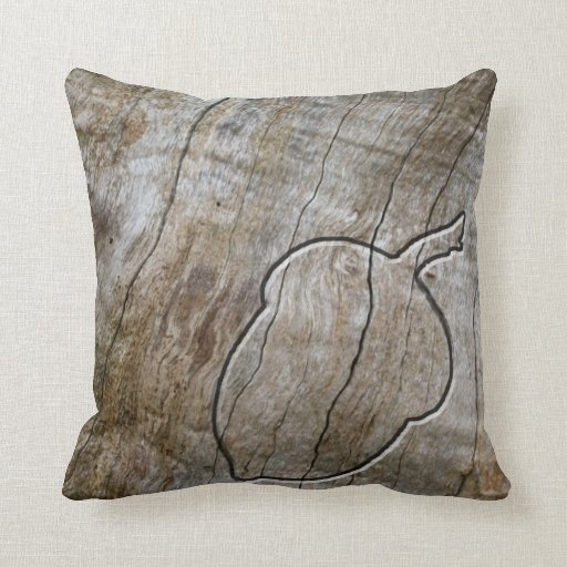 Autumnal themed acorn engraved in wood throw pillows