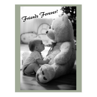 Baby and a teddy bear in black and white postcard