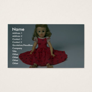 Baby girl doll dressed in red business card