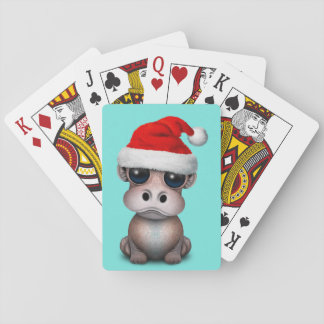 Baby Hippo Wearing a Santa Hat Playing Cards