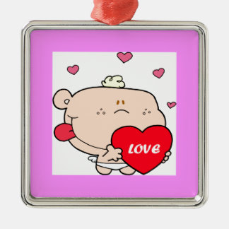 Baby Holding a Red Heart Christmas Ornament