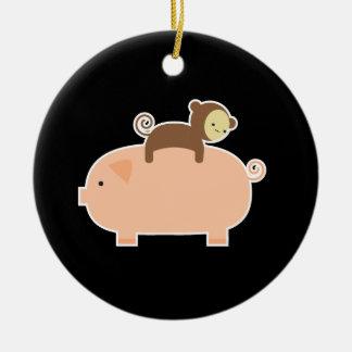 Baby Monkey Riding Backwards on a Pig Round Ceramic Decoration