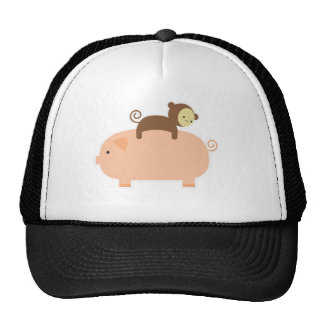 Baby Monkey Riding on a Pig Cap