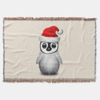 Baby Penguin Wearing a Santa Hat Throw Blanket