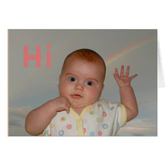 "Baby waving with ""Hi"" on a greeting card"