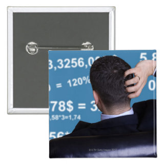 Back portrait of a businessman confused with 15 cm square badge