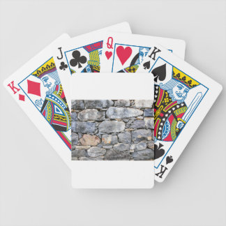 Backgound of natural stones as wall bicycle playing cards