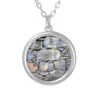 Backgound of natural stones as wall silver plated necklace