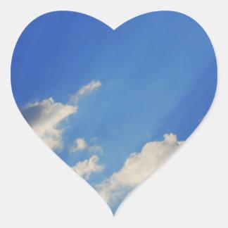 Background of blue sky. heart sticker