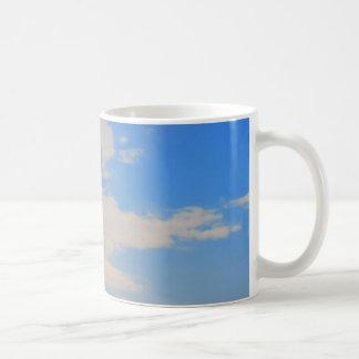 Background of blue sky. coffee mugs