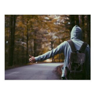 backpack hitchhiking postcard