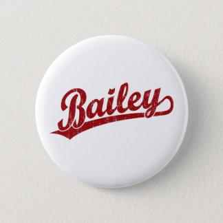 Bailey script logo in red 6 cm round badge