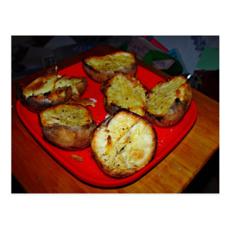 Baked Potatoes on red plastic plate Post Cards