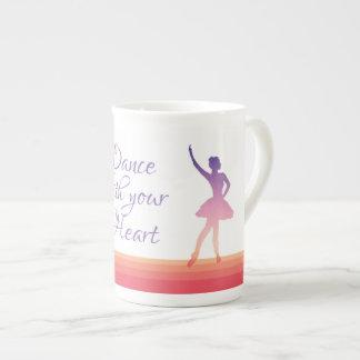 Ballerina girl silhouette dancing in purple/pink tea cup