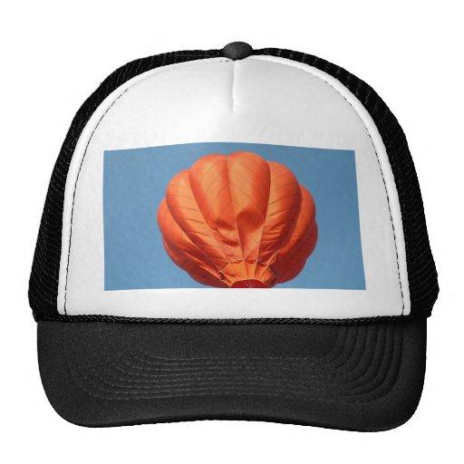 Balloon lifting off 2 hats