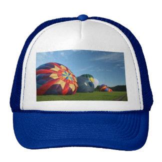 Balloons resting mesh hats