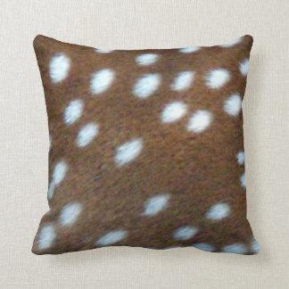 Bambi white spots on a brown fur cushion