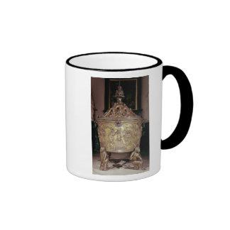 Baptismal font showing mug