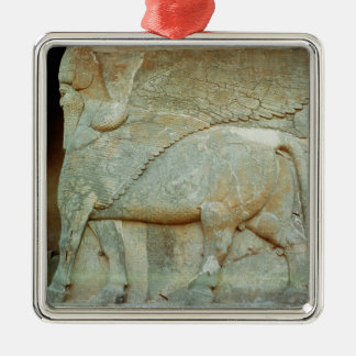 Bas-relief of an anthropomorphic bull metal ornament