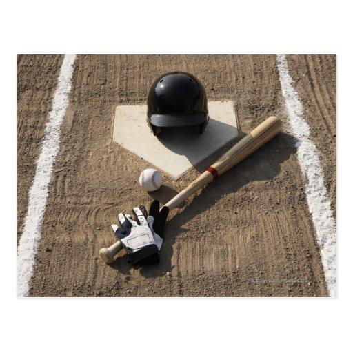 Baseball, bat, batting gloves and baseball post cards