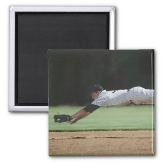 Baseball player in mid-air catching ball. square magnet