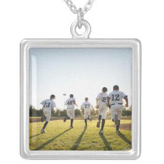 Baseball players (10-11) running on baseball jewelry