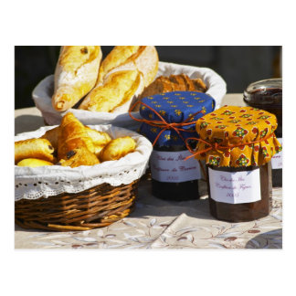 Basket with croissants and chocolate breads. postcard