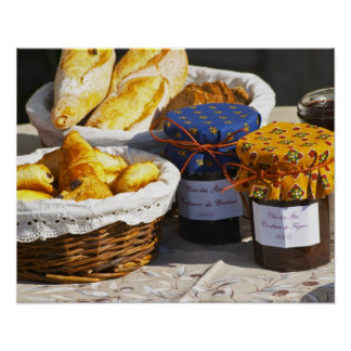 Basket with croissants and chocolate breads. poster