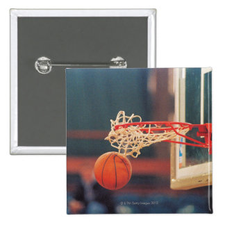 Basketball dropping through hoop 15 cm square badge