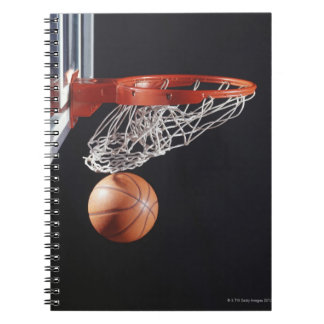 Basketball in hoop, close-up notebooks