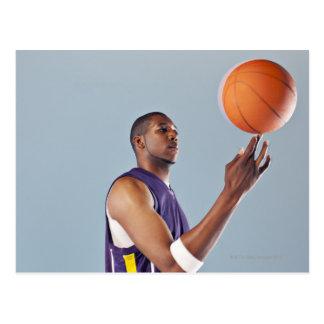 Basketball player balancing ball on one finger postcard