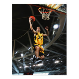 Basketball player  jumping in air postcard
