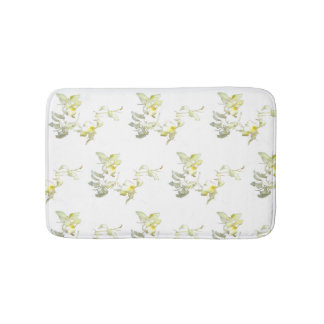 Bath mat with white and yellow tropical flowers