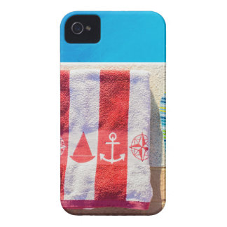 Bathing slippers and bath towel at swimming pool Case-Mate iPhone 4 cases